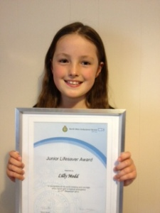 Lily with her certificate